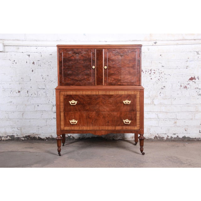 """An extremely rare and exceptional walnut gentleman's chest from """"The All Walnut Line"""" by Herman Miller, circa 1920s. The..."""
