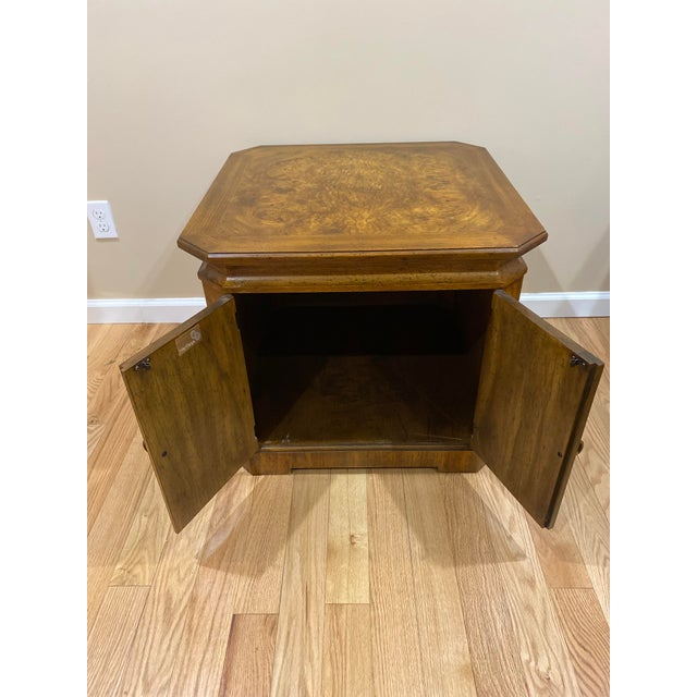 Beautiful wood table. Cupboard style doors open for large storage space.