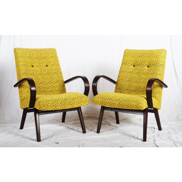 This pair of armchairs from the mid-1960s are made from beech wood and bentwood with upholstery, remaining in an original...