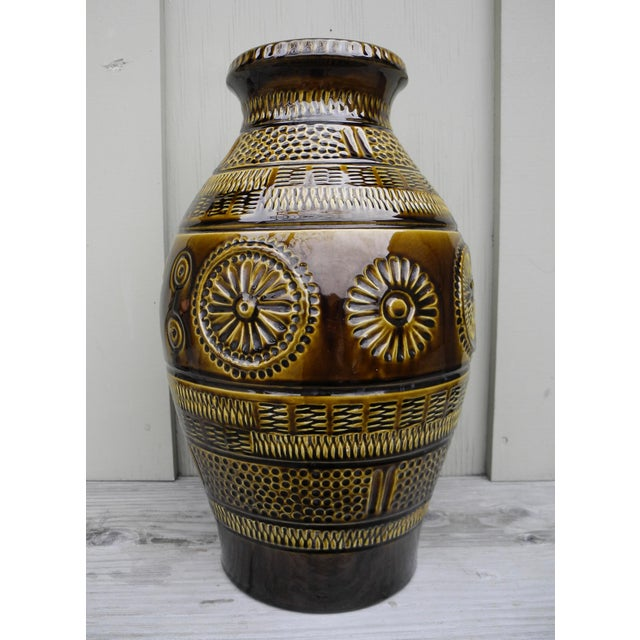 This large ceramic pottery jar has a basket motif and was made in the former West Germany. The glaze is a golden dark...