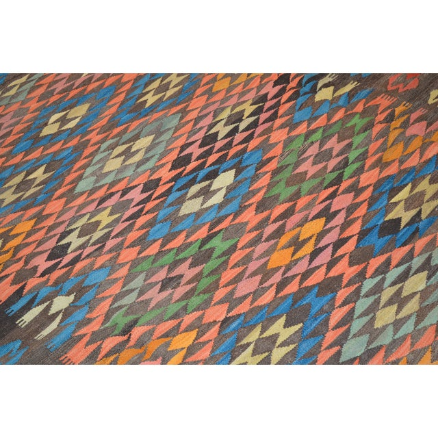 Maimana Kilims are beautifully woven in Afghanistan and recognizable by the rhythmic geometric patterns and rich colors.