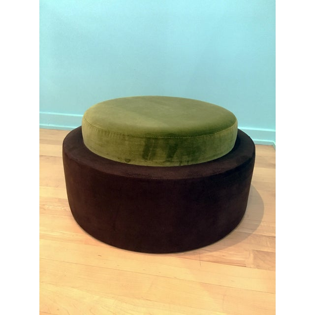 Custom Ottoman with contrasting green, jewel toned velvet seat with charcoal ultra-suede sides. Features firm foam over...