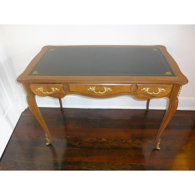 French ladies writing desk, circa 1960. Black leather and gilt-embossed writing surface, brass handles, and Queen Anne...