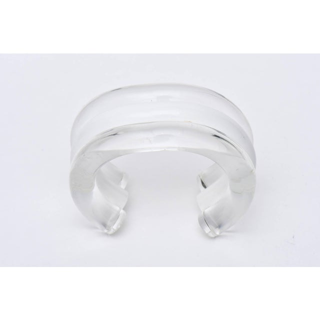 The bands of clear, white and then clear again make this very chic chunky lucite cuff bracelet from the 80's so wearable...