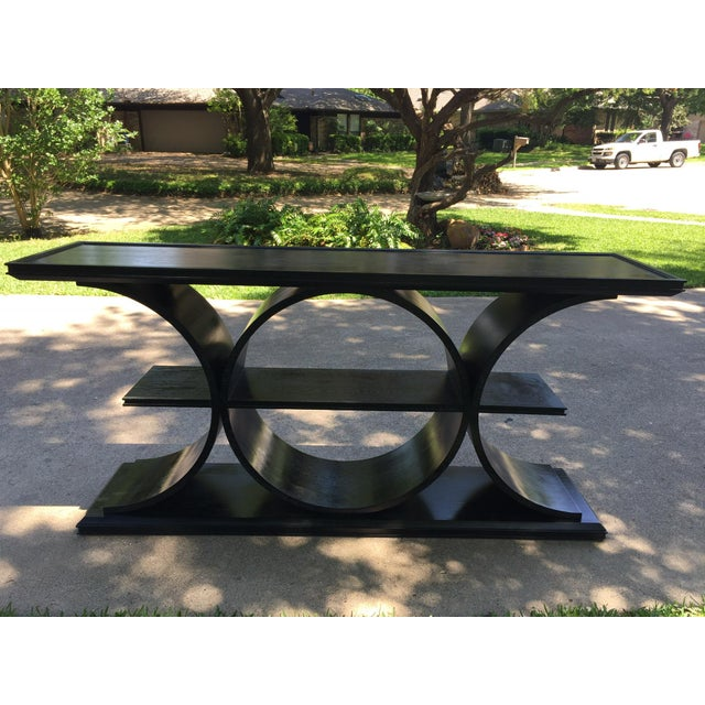 This beautiful modern console table is a statement piece! The architectural lines work well with all styles and design....