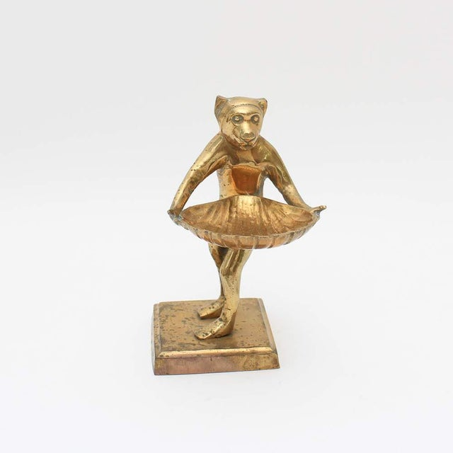 This is a vintage brass monkey butler card holder. He's holding a shell tray. This would be cute to hold your business...
