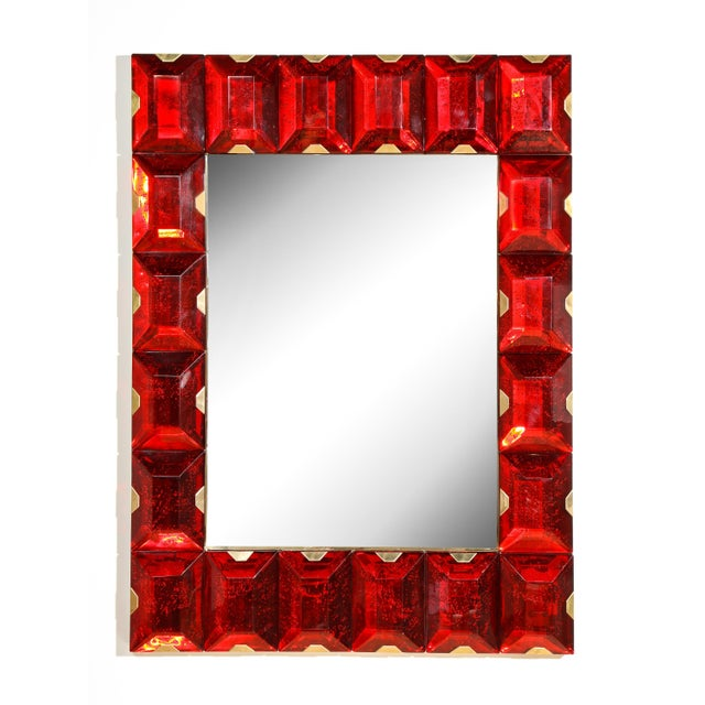 Large contemporary Murano mirror with solid cast red glass tiles and brass hardware.