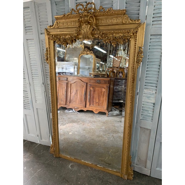 Beautiful Louis XVI period mirror with original giltwood frame and original glass. Extremely detailed unique carvings. The...