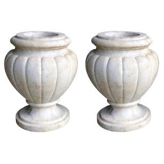 A Large and Refined Pair of Italian Neoclassical Style Carved Carrera Marble Lobed Urns