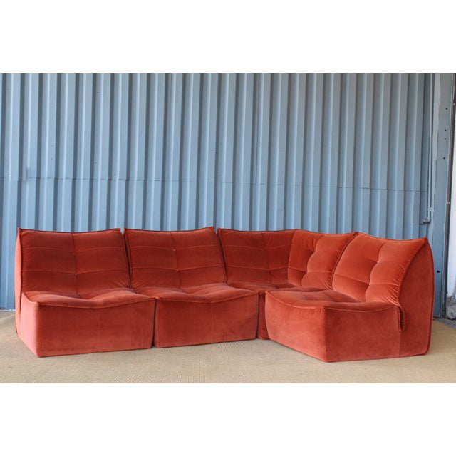 1970s Italian made modular sofa with new burnt orange velvet upholstery. With all four pieces combined this sofa measures...