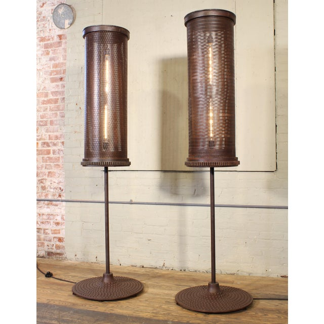 These 6-ft.-tall floor lamps are formed from early 20th-century factory tumblers atop cast-iron machine bases with a...