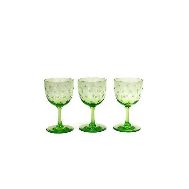 Set of nine antique hand-blown uranium glass wine stems. Each glass have hand cut stars around the goblet. No maker's mark.