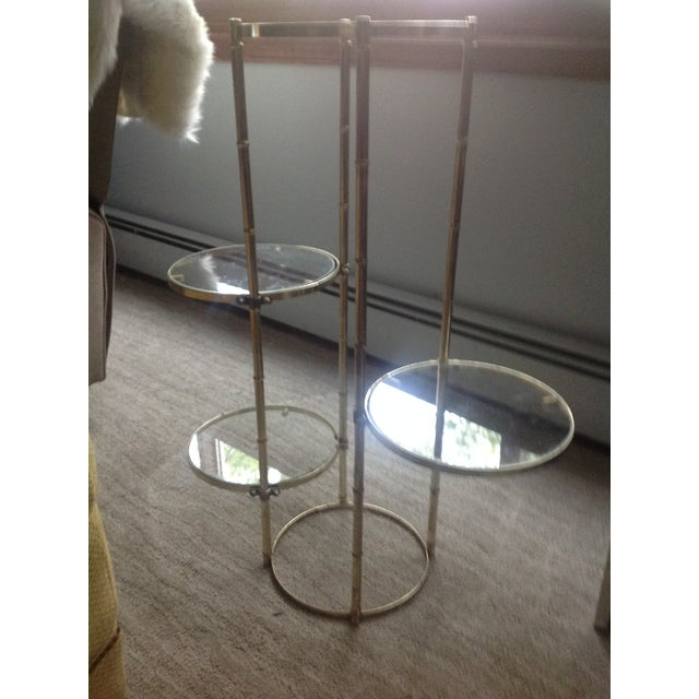 Mid Century faux brass and glass shelving stand. Great plant stand or display your favorite collectibles. Each glass shelf...