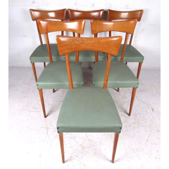 This stylish set of six sculptural dining chairs features a unique Ico Parisi style design as well as comfortable...