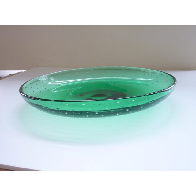 Hand blown glass bowl with concentric air bubbles, deep emerald green color.