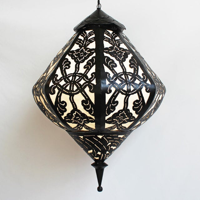 Striking black and white decorative lanterns. A variety of shapes and sizes available. Matte black handout iron work with...
