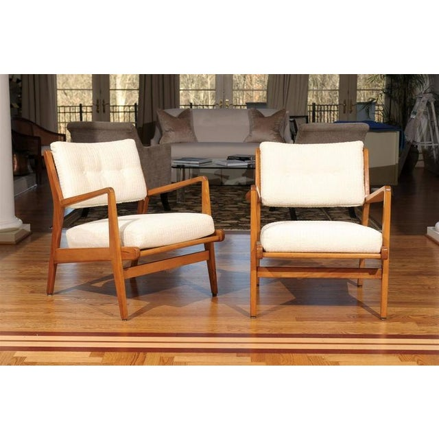 A beautiful pair of vintage lounge or armchairs by Jens Risom in Maple, circa 1960. A handsome design which offers great...