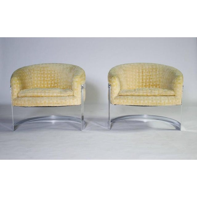 Milo Baughman chrome cantilevered barrel chairs in original yellow patterned fabric and removable cushions. Chrome in...