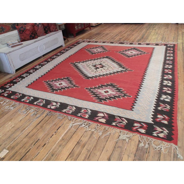 A very nice old Kilim from the Balkans in square-ish format. The blue-gray inner border is unusual.