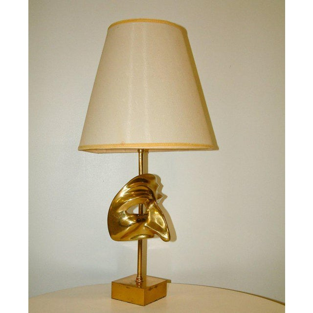 France Circa 1970 A stunning modern commedia dell'arte cast brass lamp wired to American standards. Very good condition...