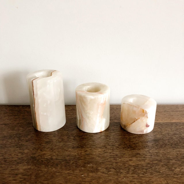 """Vintage 1960s onyx candle holders, made in Pakistan. Beautiful marbling and modern column shape. Largest: 2.25"""" x 4""""..."""