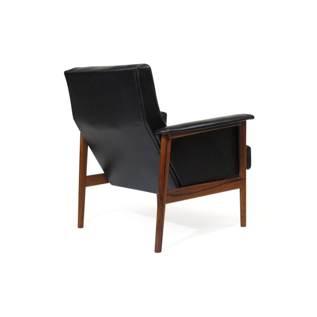 Mid-century Danish rosewood lounge chair newly upholstered in fine black leather, raised on a Brazilian Rosewood frame...