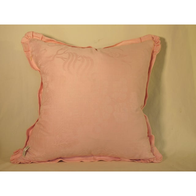 A pillow made from a circa 1880s French printed cotton, edged and backed wi h hand dyed linen Damask with a hidden zipper...