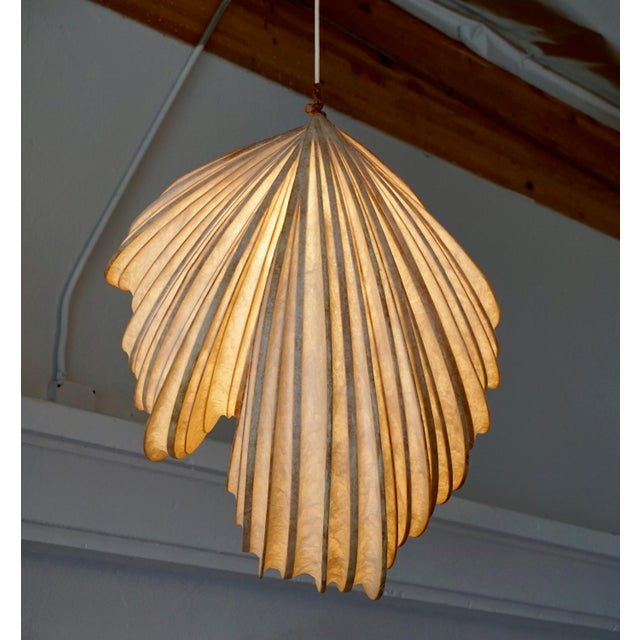 Leslie makes these one of a kind hanging light sculptures out of bentwood and a fiber resin that emulates rice paper.
