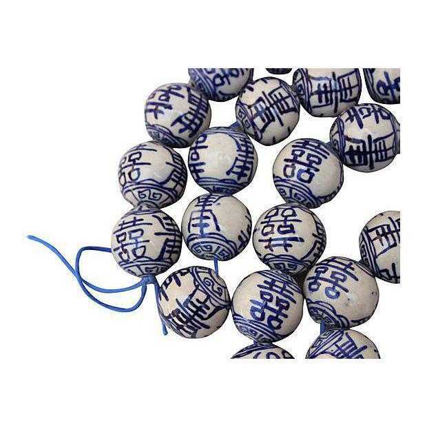 "50 hand-painted porcelain beads with ""double happiness"" in Chinese painted on each. Each bead, 1.3/4""Dia. Strung together..."