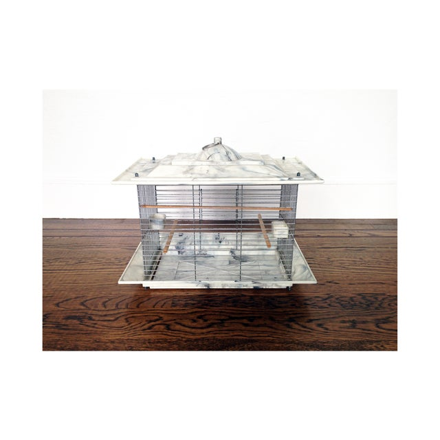 A stunning rectangular Mid Century bird cage. The top and bottom are made of bakelite with a gorgeous gray and white...
