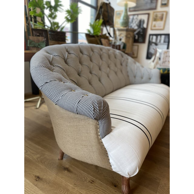 Seat: upholstered in a black and white stripe cotton/ linen. Tufted Back: upholstered in a coordinating black and white...