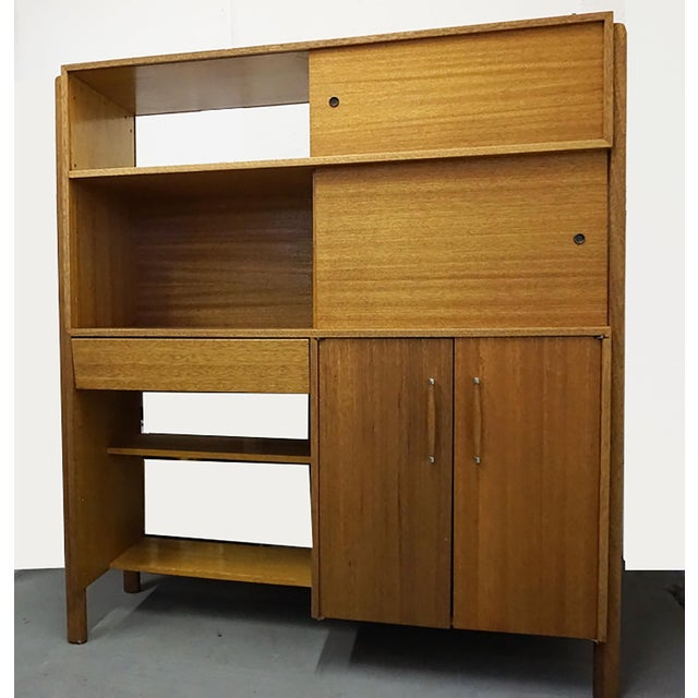 Blonde mahogany room divider by John Keal for Brown Saltman. John Keal designed furniture for furniture manufacturer Brown...