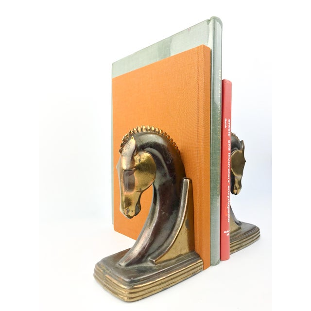 Beautiful pair of Vintage Art Deco Era bronze + copper Trojan horse bookends manufactured by Dodge in the 1930s....