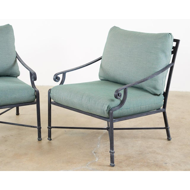 Generous pair of patio and garden lounge chairs made by Brown Jordan. Constructed from wrought aluminum with a multi-step...
