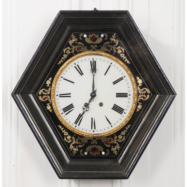 This Stunning French 19th century Boulle-work brass, tortoiseshell, and mother of pearl inlaid wall clock is in working...