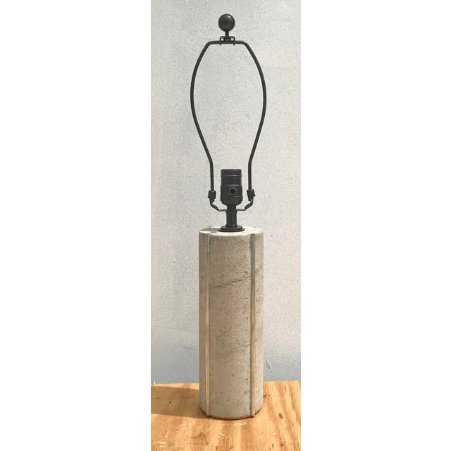 This unique cylindrical table lamp is constructed out of hand poured concrete. Four round channels are then created for...