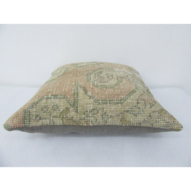 This is a pillow cover made from a vintage kilim rug. The piece was properly washed and ready to use. Pillow inserts not...