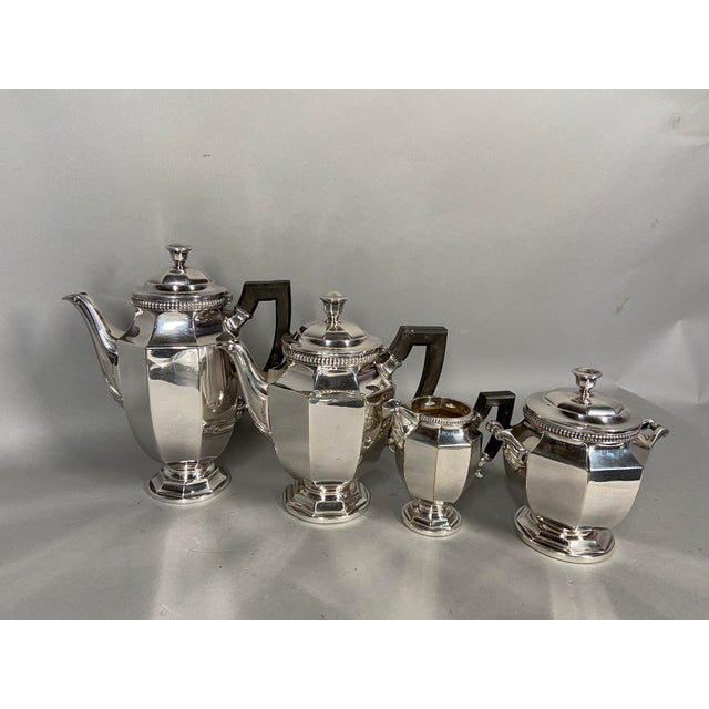 The set consists of a coffee pot, a tea pot, a sugar pot and a milk jar and of course the large tray to put it all on. It...