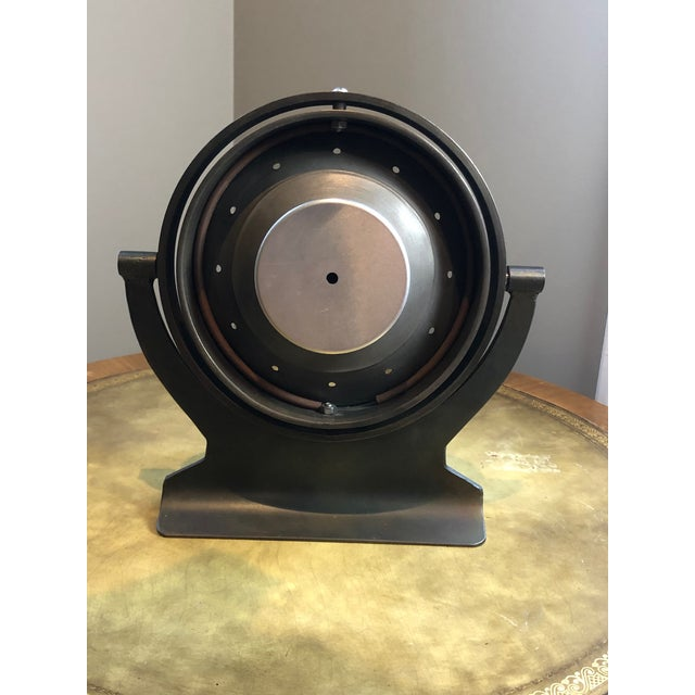 Gorgeous Aviator-Style, Industrial, Heavy, Metal Clock. Ability to tilt face all the way around. Doesn't work but I'm not...