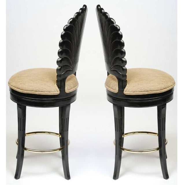 Beautifully carved and detailed bar stools with scalloped shell shaped back with circular brass stretchers. The bar stools...