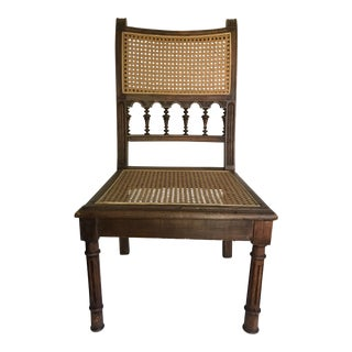 Early 20th Century Antique Wood and Cane Low Chair For Sale