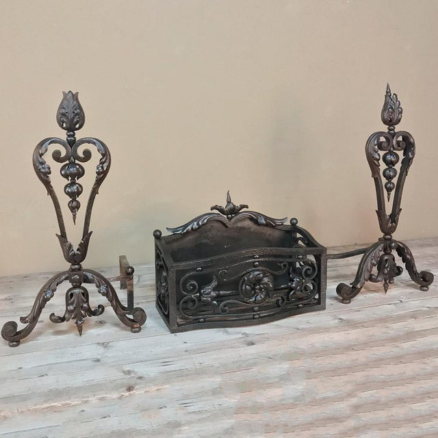 19th Century Wrought Iron Andiron & Firebox Set is a master work of the blacksmith's art, forged from red-hot iron to last...