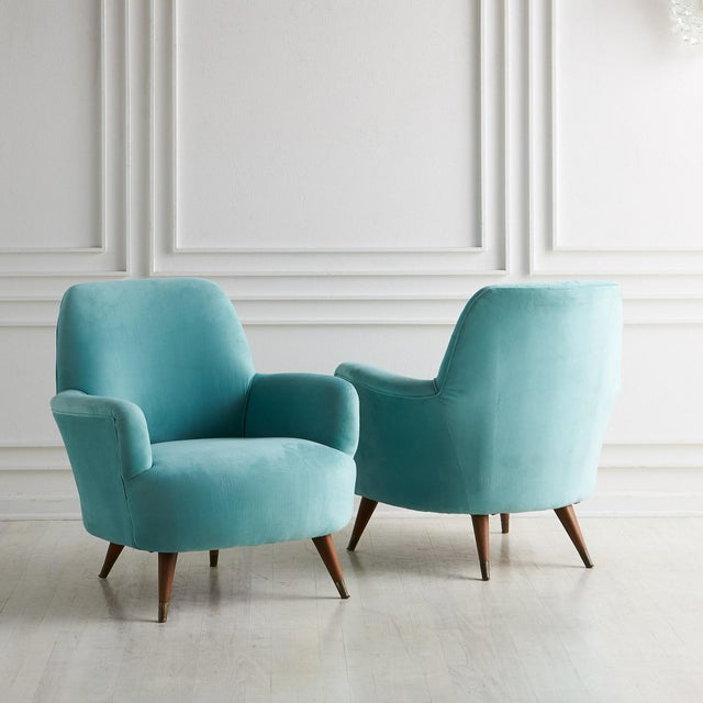 A pair of Italian Midcentury Modern Upholstered Lounge Chairs recently upholstered (not by our showroom) in a light blue...