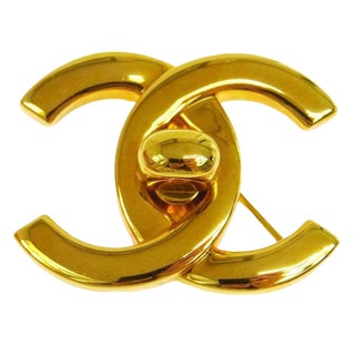 Chanel Vintage Gold Turnlock Charm Evening Pin Brooch in Box For Sale
