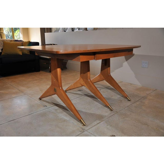 Drop leaf table with brass sabots and decorative brass details in the manner of Gio Ponti.