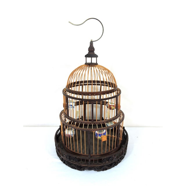 A very beautiful two tone vintage hand made Chinese Bird Cage. This particular wood, cane and bamboo bird cage has 5...