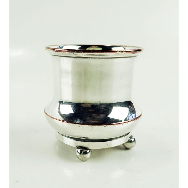 Vintage silver over copper footed cup with the three feathers and crown badge of the Prince of Wales engraved on the side....