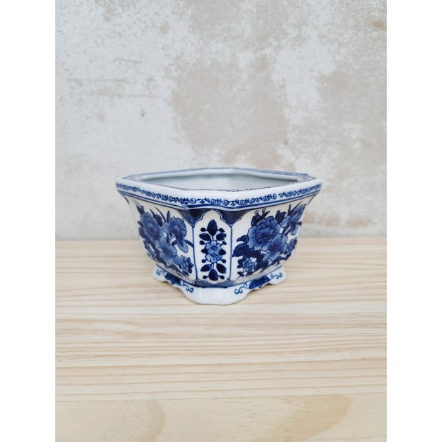 Classic blue and white glazed ceramic planter. We love the floral motif and varying shades of blue that gives this piece...