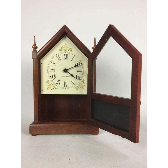 Battery operated Seth Thomas design steeple clock. This clock is in both the gothic and cottage style.