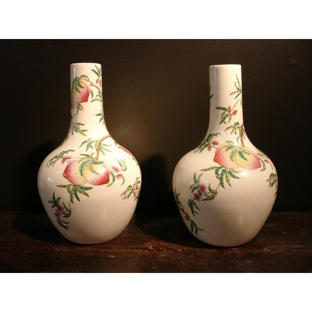 "A Pair of Famille Rose ""Peaches"" Bottle Vases (Tianquiping) For Sale - Image 4 of 7"